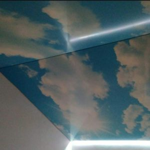 натяжные потолки с облаками
